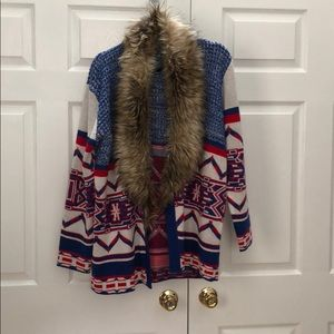 MinkPink attaches faux fur sweater
